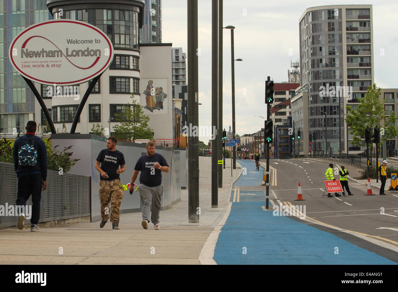 London, UK, 07th July, 2014. East Londoners seen walking along a closed  Stratford High Street as the Tour de France - Stock Image