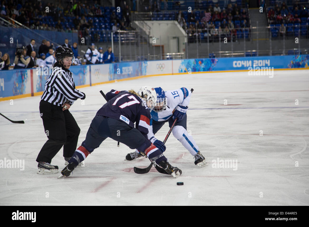 Jocelyne Lamoureux (USA) and Minttu Tuominen (FIN) faceoff during ice hockey game at the Olympic Winter Games, Sochi - Stock Image