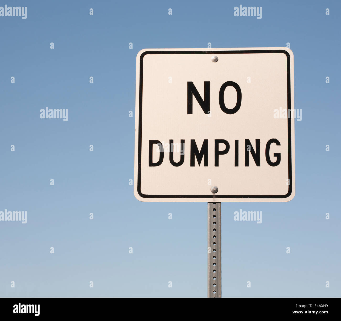 No dumping sign and blue sky. - Stock Image