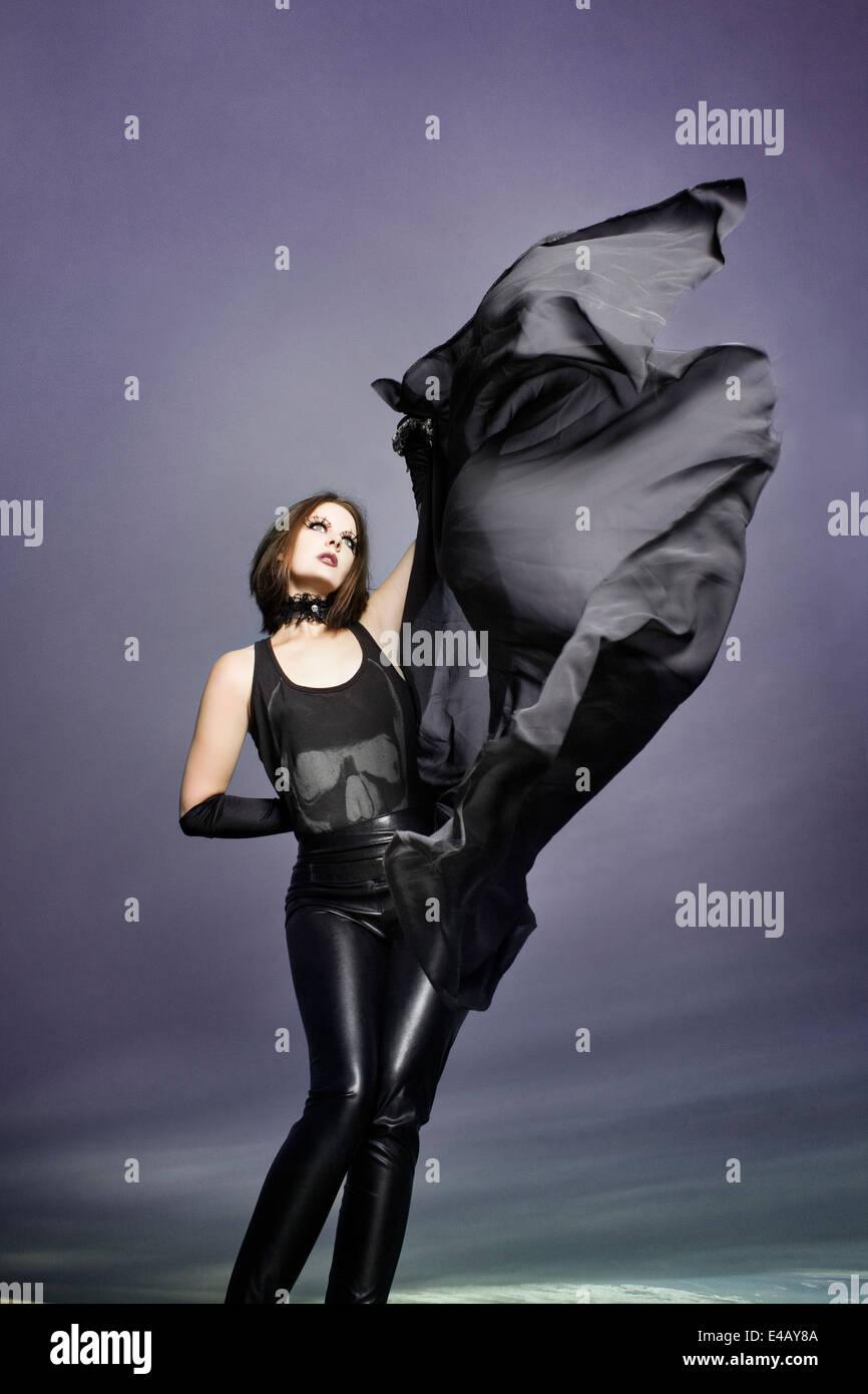 Beautiful woman dancing with long chiffon shawl - Stock Image