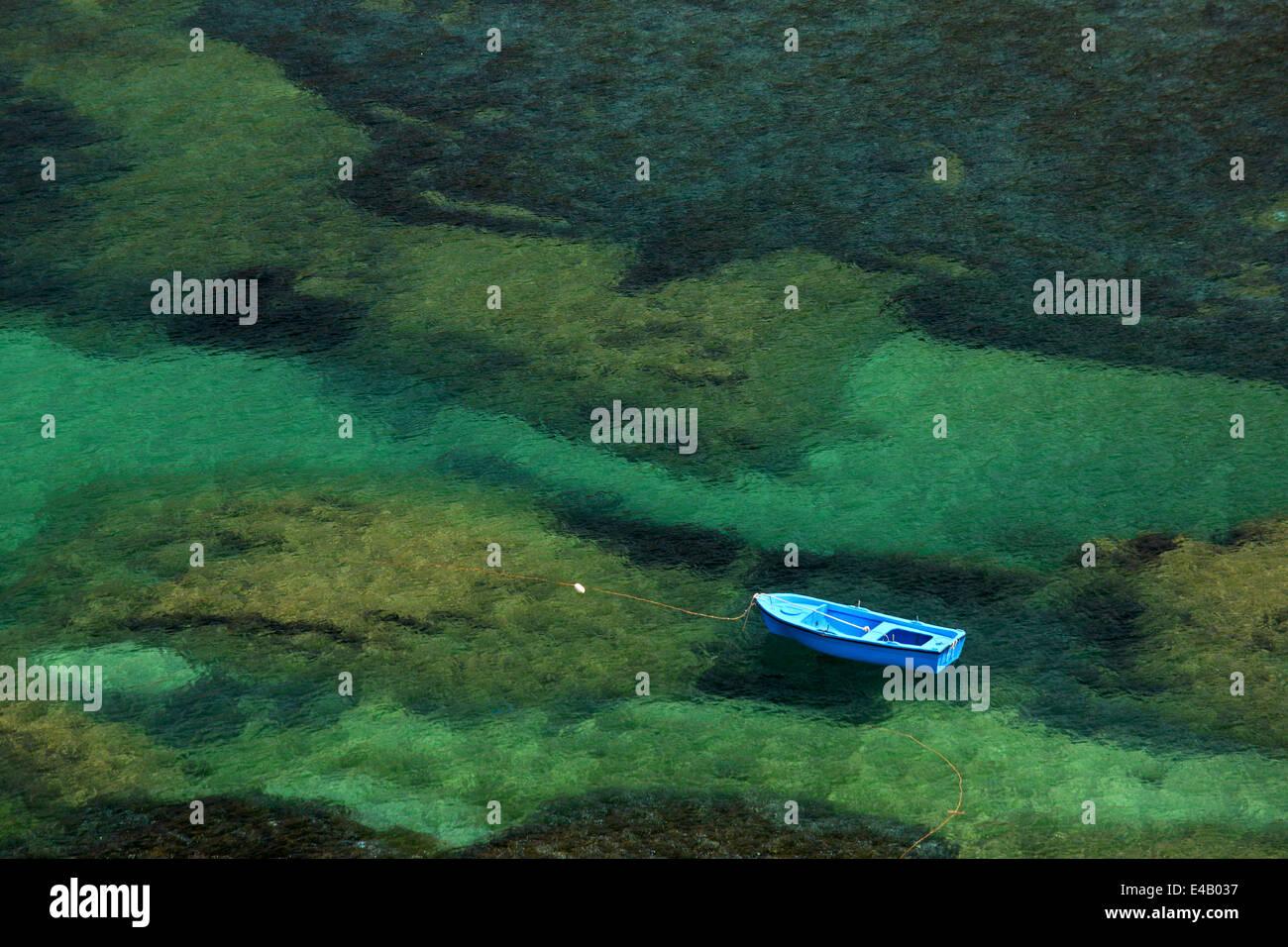 'Lonely' boat close to Emboreios village (Alexis beach), Kalymnos island, Dodecanese, Aegean sea, Greece - Stock Image