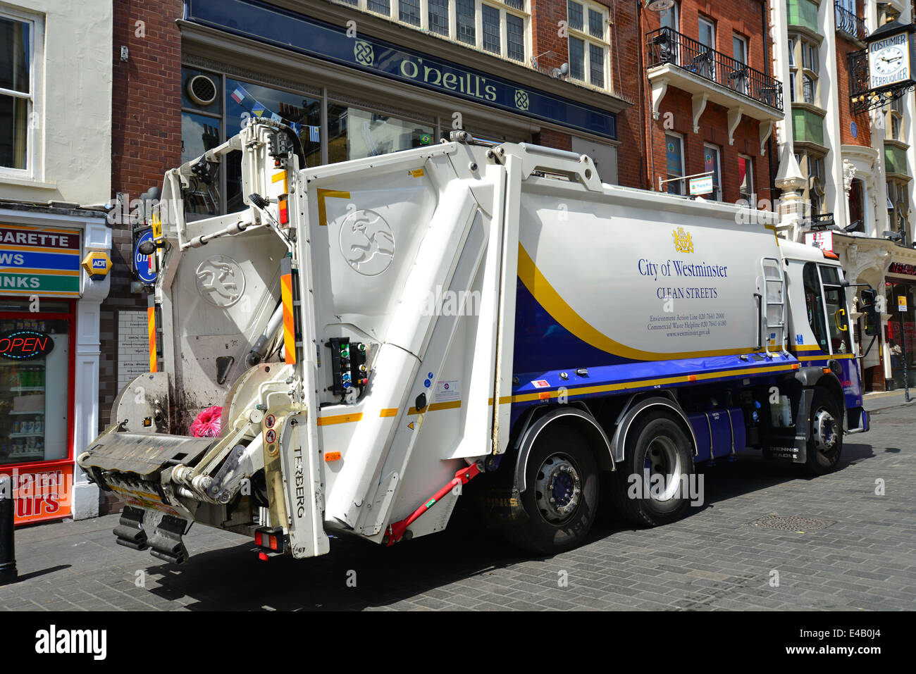 Rubbish truck collection in Wardour Street, Chinatown, West End, City of Westminster, London, England, United Kingdom Stock Photo