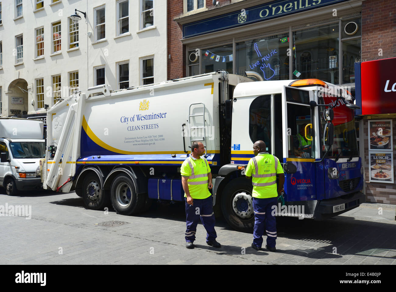 Rubbish truck collection in Wardour Street, Chinatown, West End, City of Westminster, London, England, United Kingdom - Stock Image