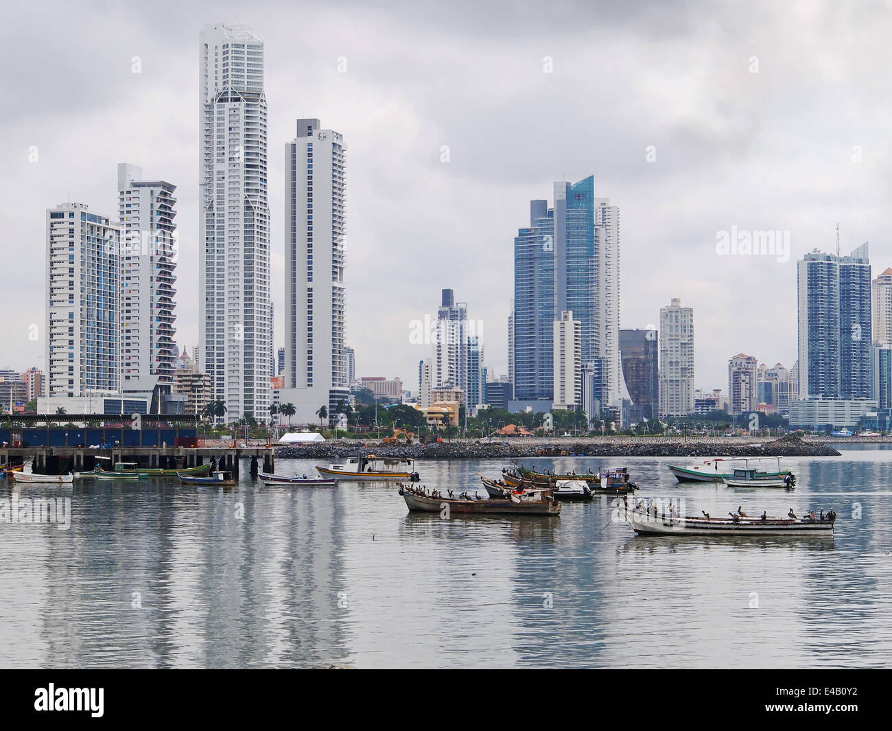 Fishing boats anchored with skyscrapers of Panama City, Pacific coast, Central America - Stock Image