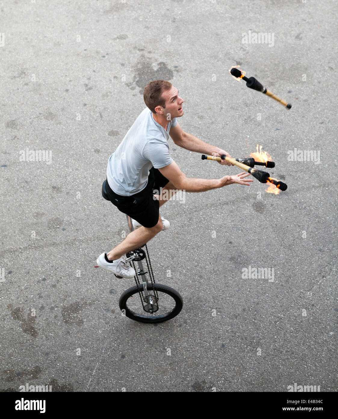 A unicyclist performs at Summerfest, an annual music festival held in Milwaukee, Wisconsin USA. - Stock Image