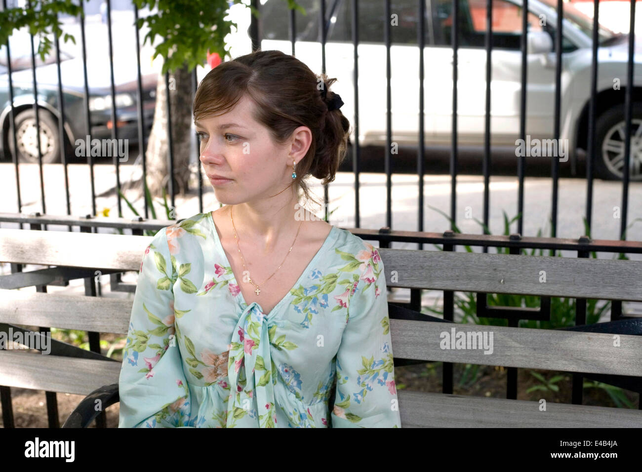 girl sits in the park. She was in her late twenties at the time of shoot.  - Stock Image