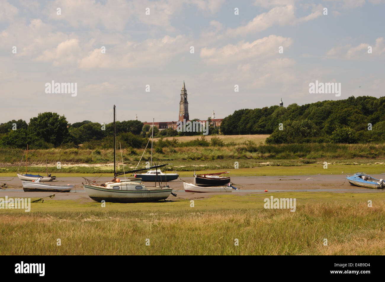 Holbrook Bay on the River Stour, Suffolk, U with the spire of the Royal Hospital School visible in the background. - Stock Image