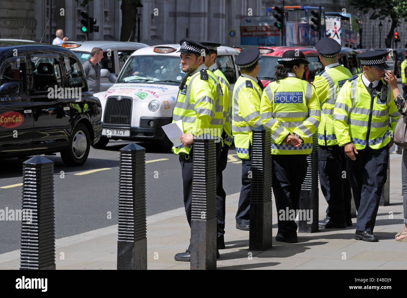 London, England, UK. Metropolitan police officers on duty during a taxi drivers' protest in central London, - Stock Image