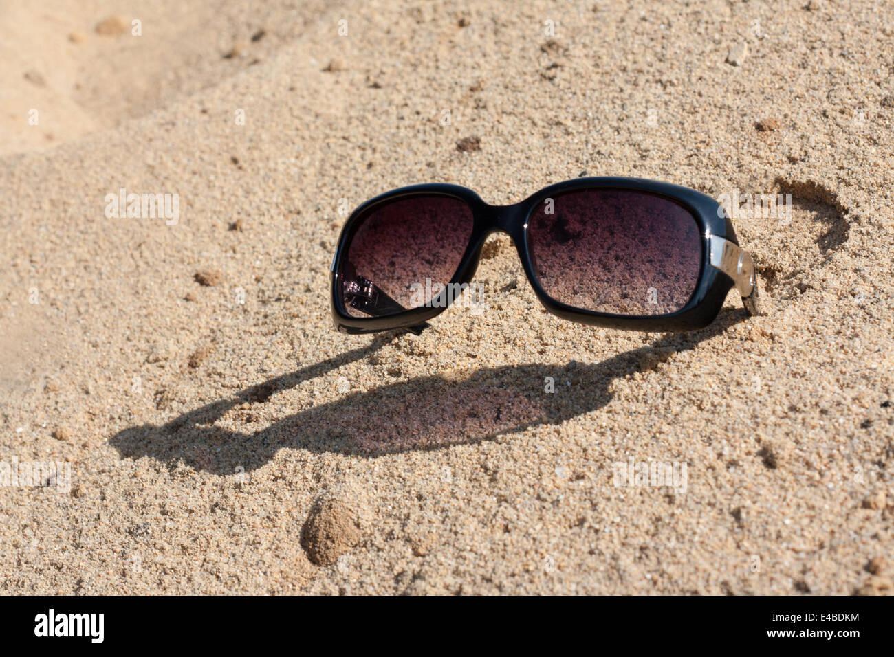 b9a365de8f9c Sunglasses On Song Stock Photos   Sunglasses On Song Stock Images ...