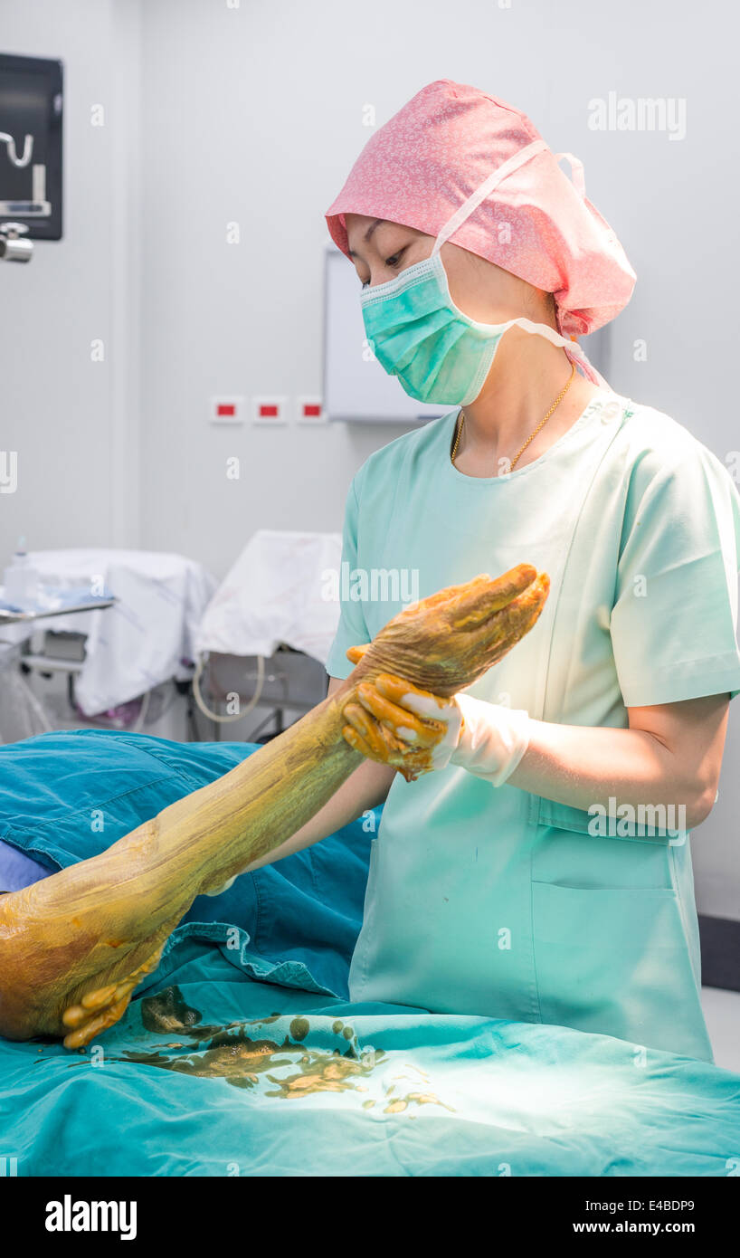 Scrub nurse use cleaning solution paint all forearm and arm prepare for operation - Stock Image