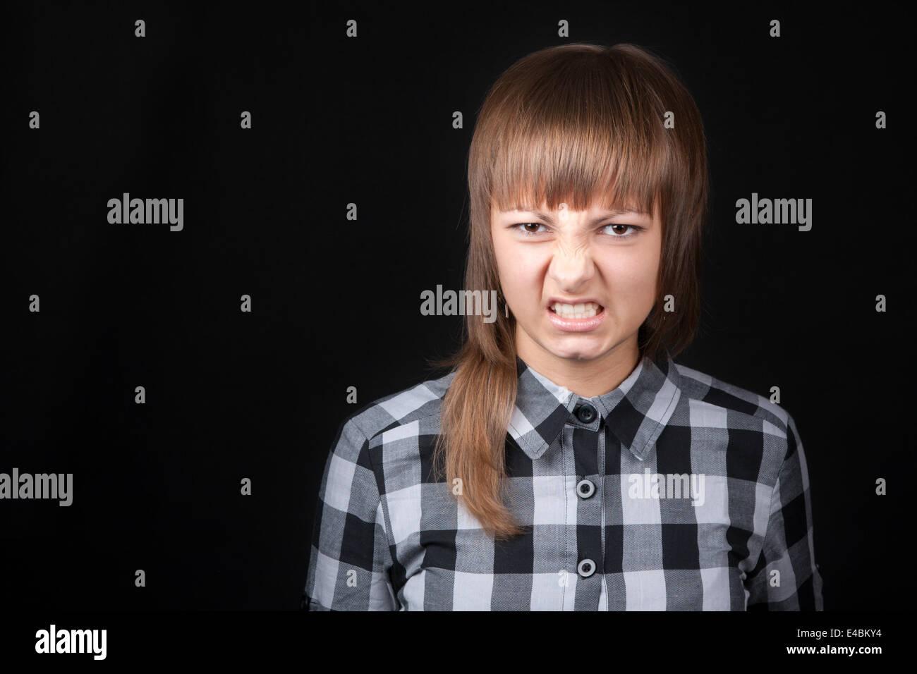 Young beautiful girl snarls - Stock Image