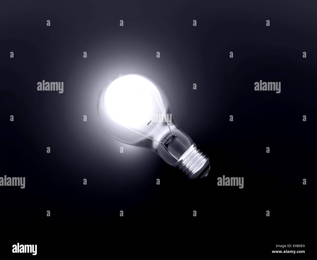 luminous bulb lies on a dark background - Stock Image