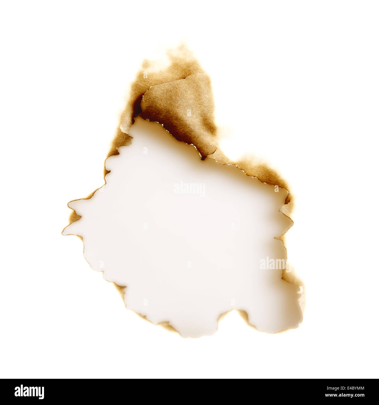 burnt hole in a white sheet of paper - Stock Image