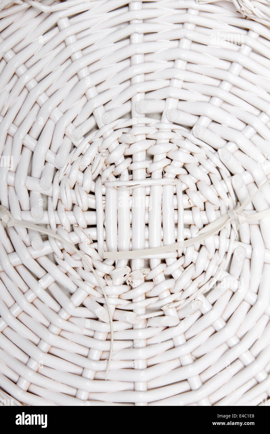 Braided basket in the manner of background - Stock Image