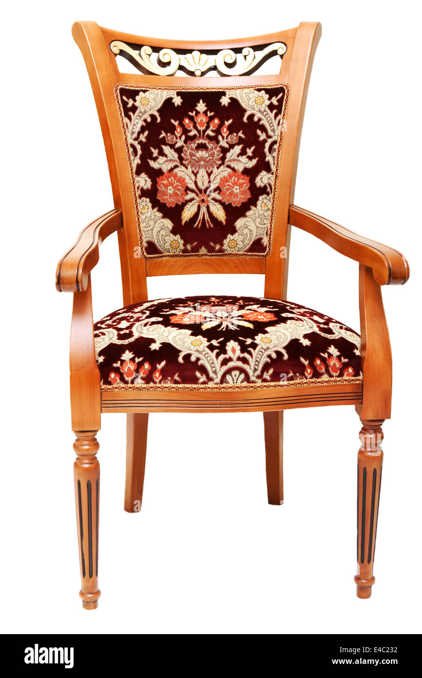 Beautiful wooden chair with expensive drapes - Stock Image
