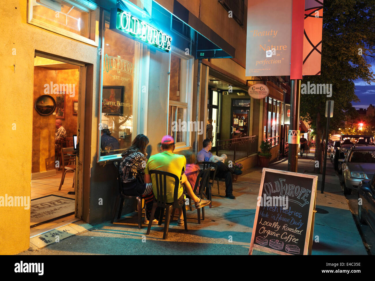 Asheville, North Carolina. People outside café at night. - Stock Image