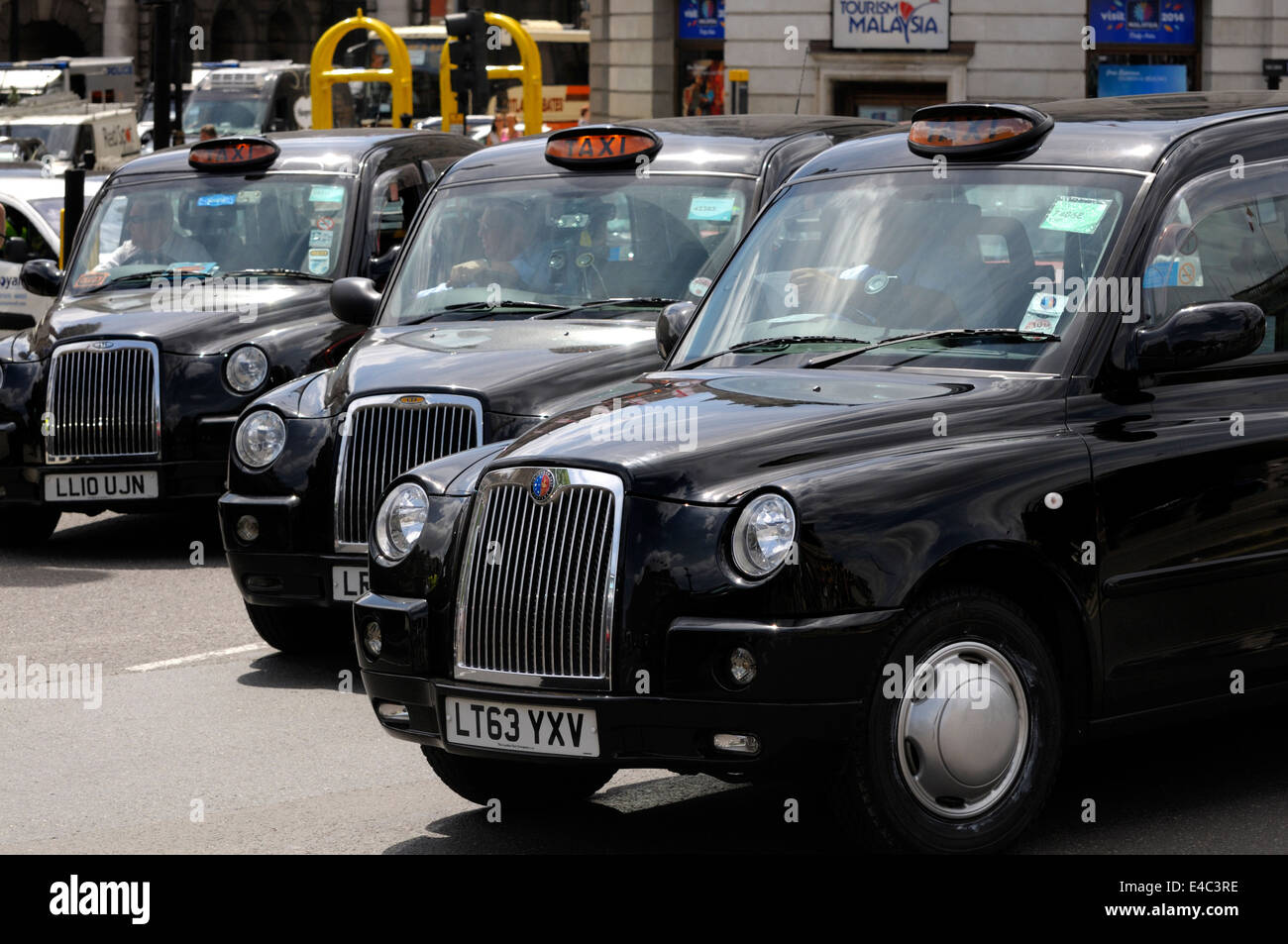 London, England, UK. Black cabs in central London - Stock Image