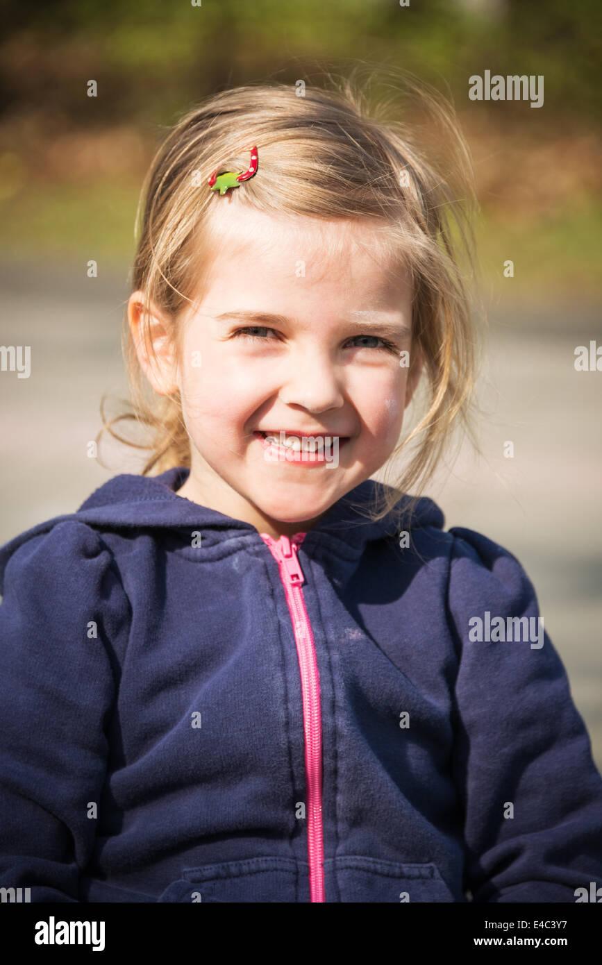 Portrait of blonde girl, smiling, Munich, Bavaria, Germany - Stock Image