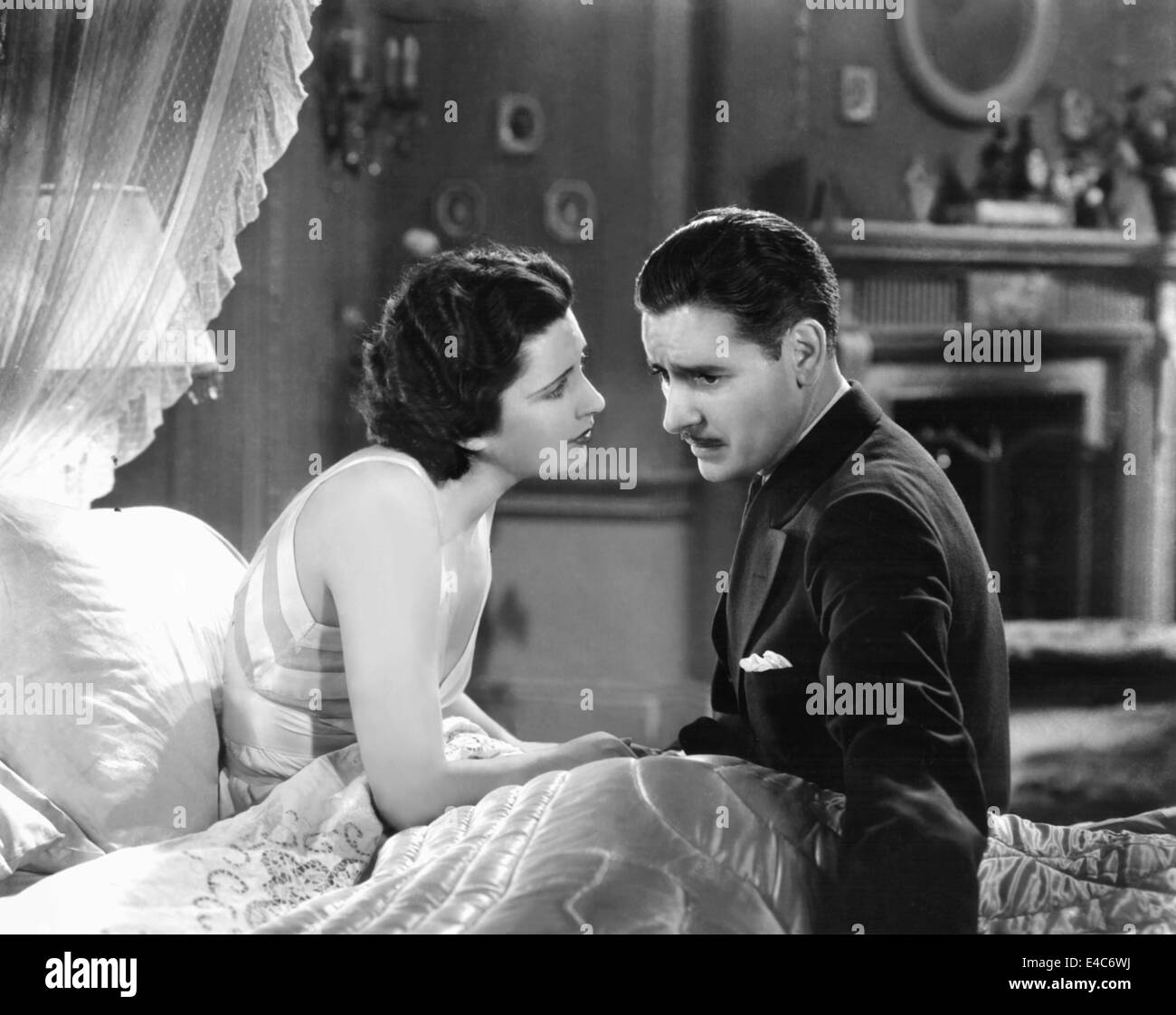 Kay Francis, Ronald Colman, on-set of the Film, 'Cynara', 1932 - Stock Image