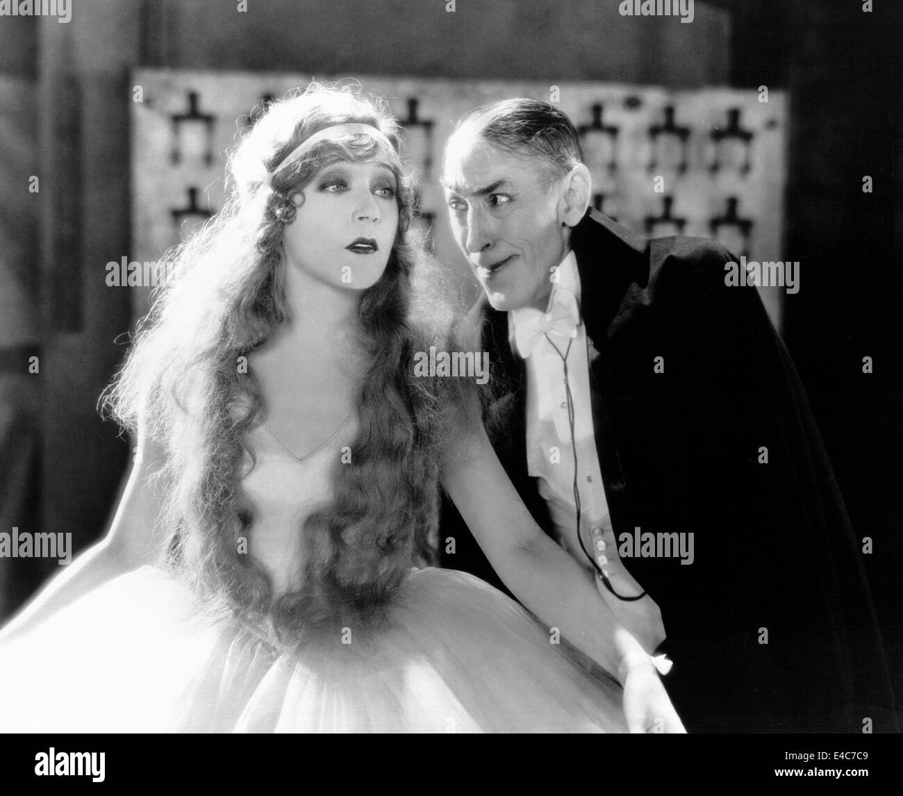 Mae Murray, Tully Marshall, on-set of the Silent Film, 'The Merry Widow', 1925 - Stock Image