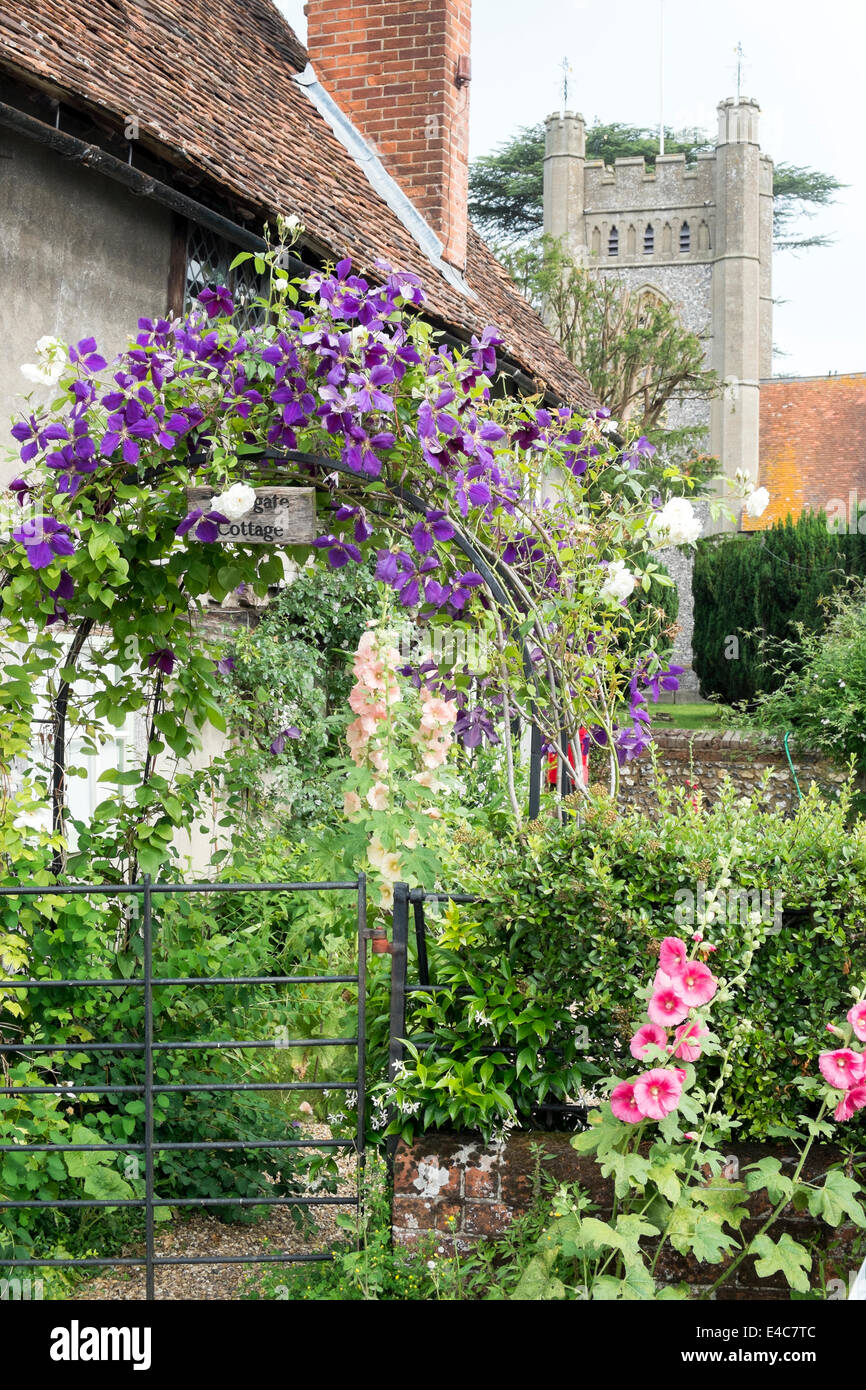 Floral arch in a front garden Hambleden village Buckinghamshire UK - Stock Image