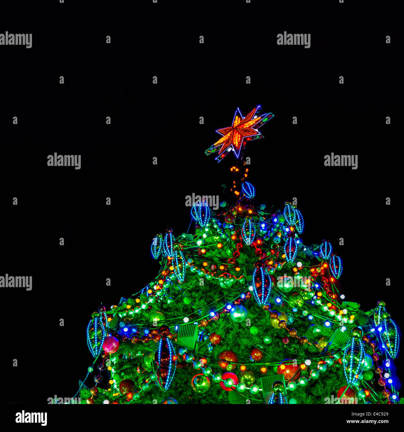 artificial christmas tree top decorated with a lot of lights balls icicles - Christmas Light Balls For Trees