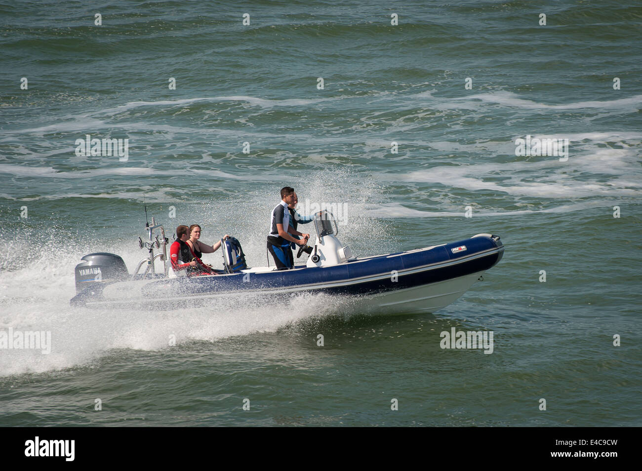 Speedboat with an outboard motor on the Solent, England. - Stock Image