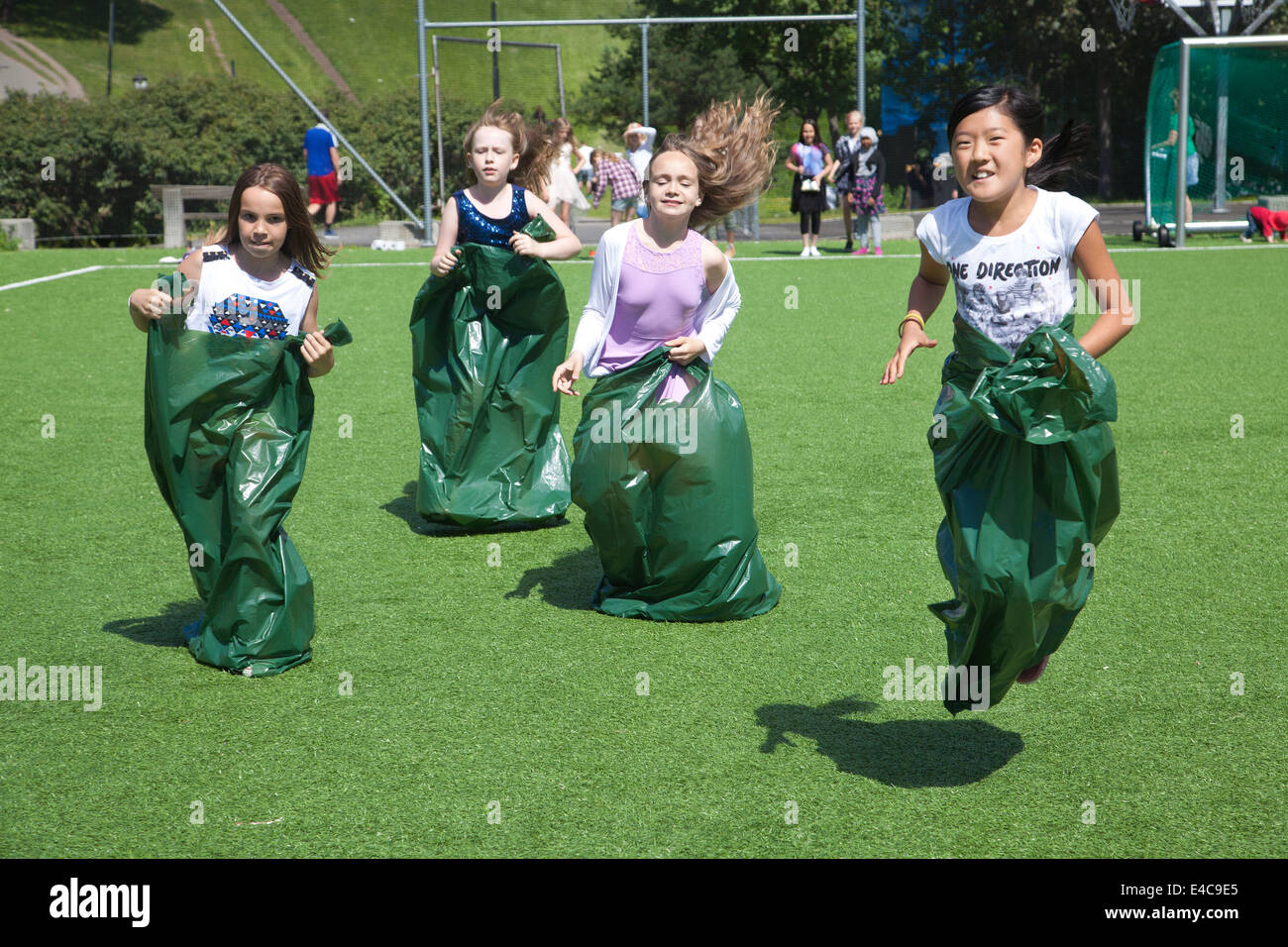 Kids potato sack racing Stock Photo
