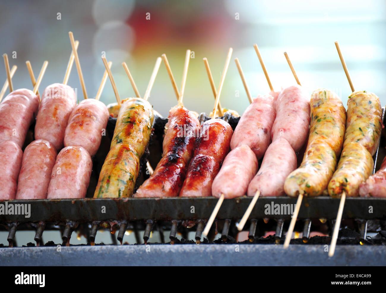 Smokies on BBQ - Stock Image