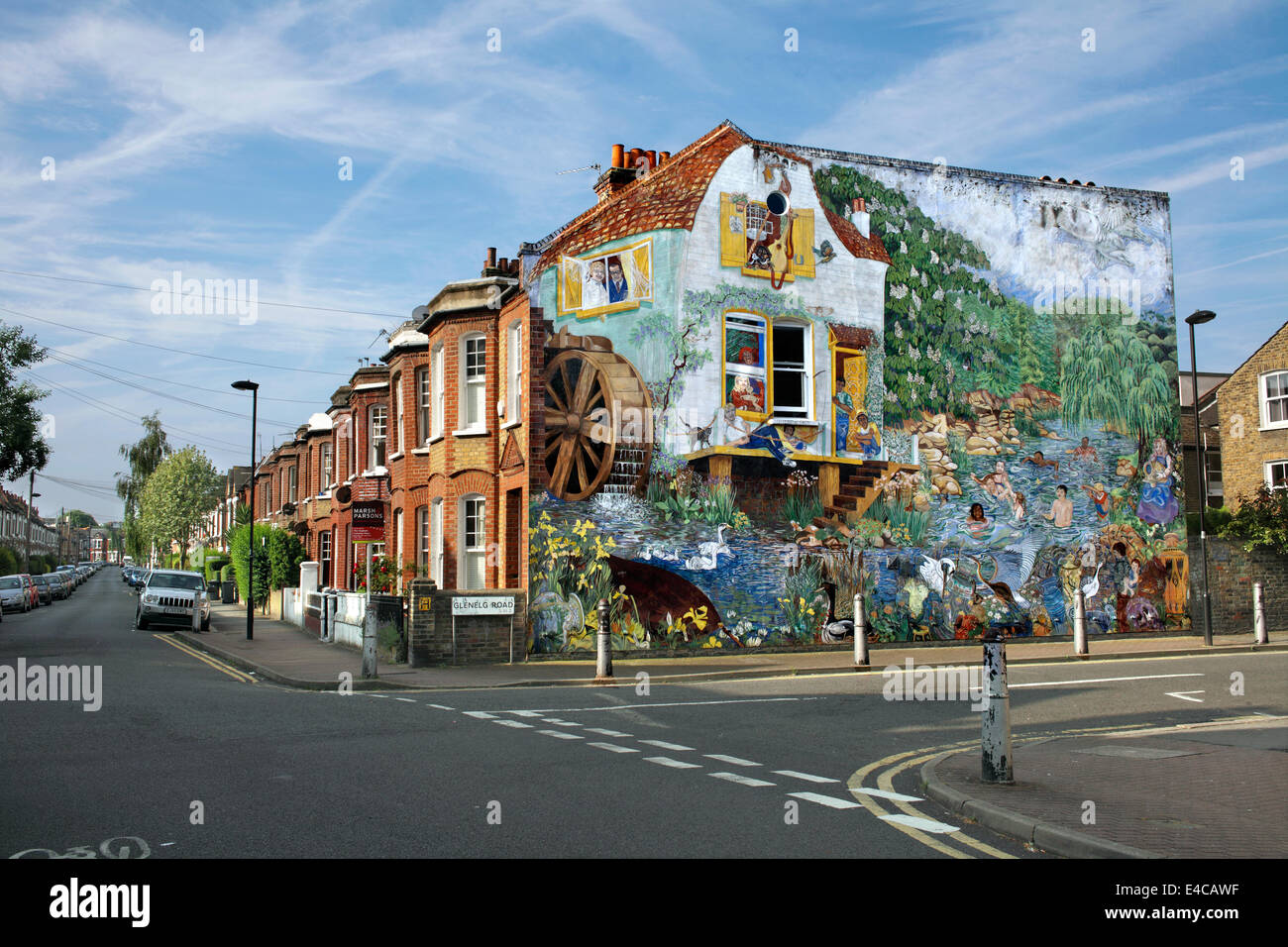 Early morning summer sun lights up the Big Splash mural on the end wall of a terraced house, Brixton, London. Stock Photo
