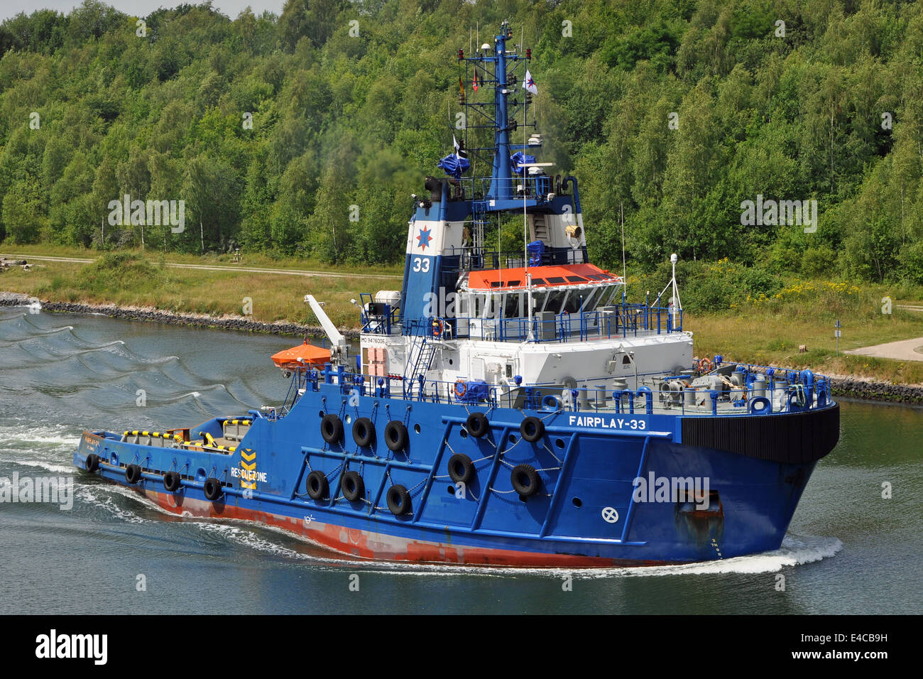 Offshore tug Fairplay-33 passing the Kiel-Canal. - Stock Image
