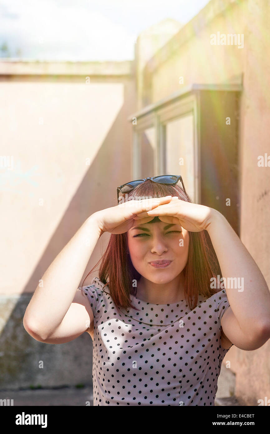 Young woman, hands covering eyes, Osijek, Croatia - Stock Image