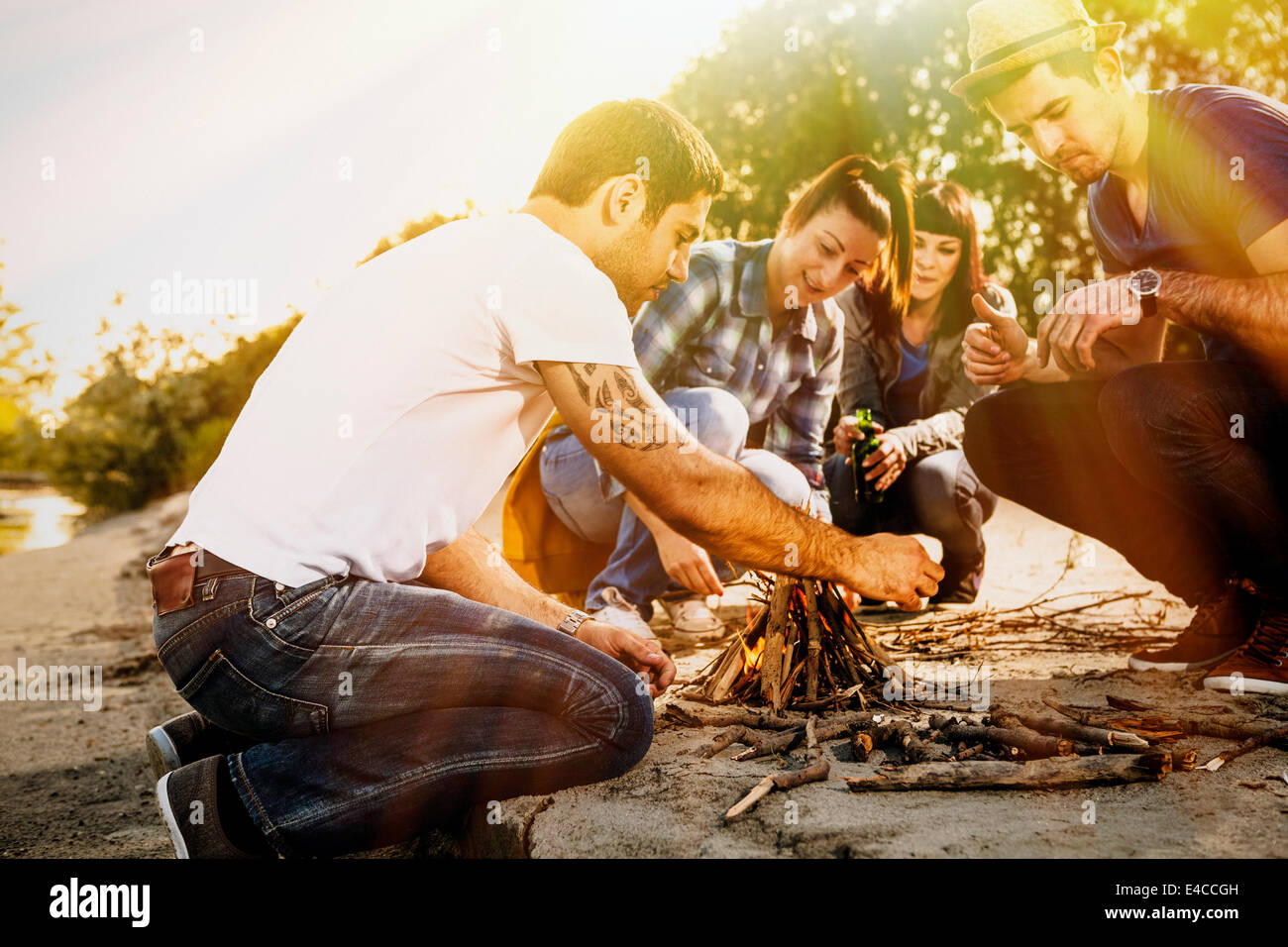 Group of friends lighting a campfire,  Osijek, Croatia - Stock Image