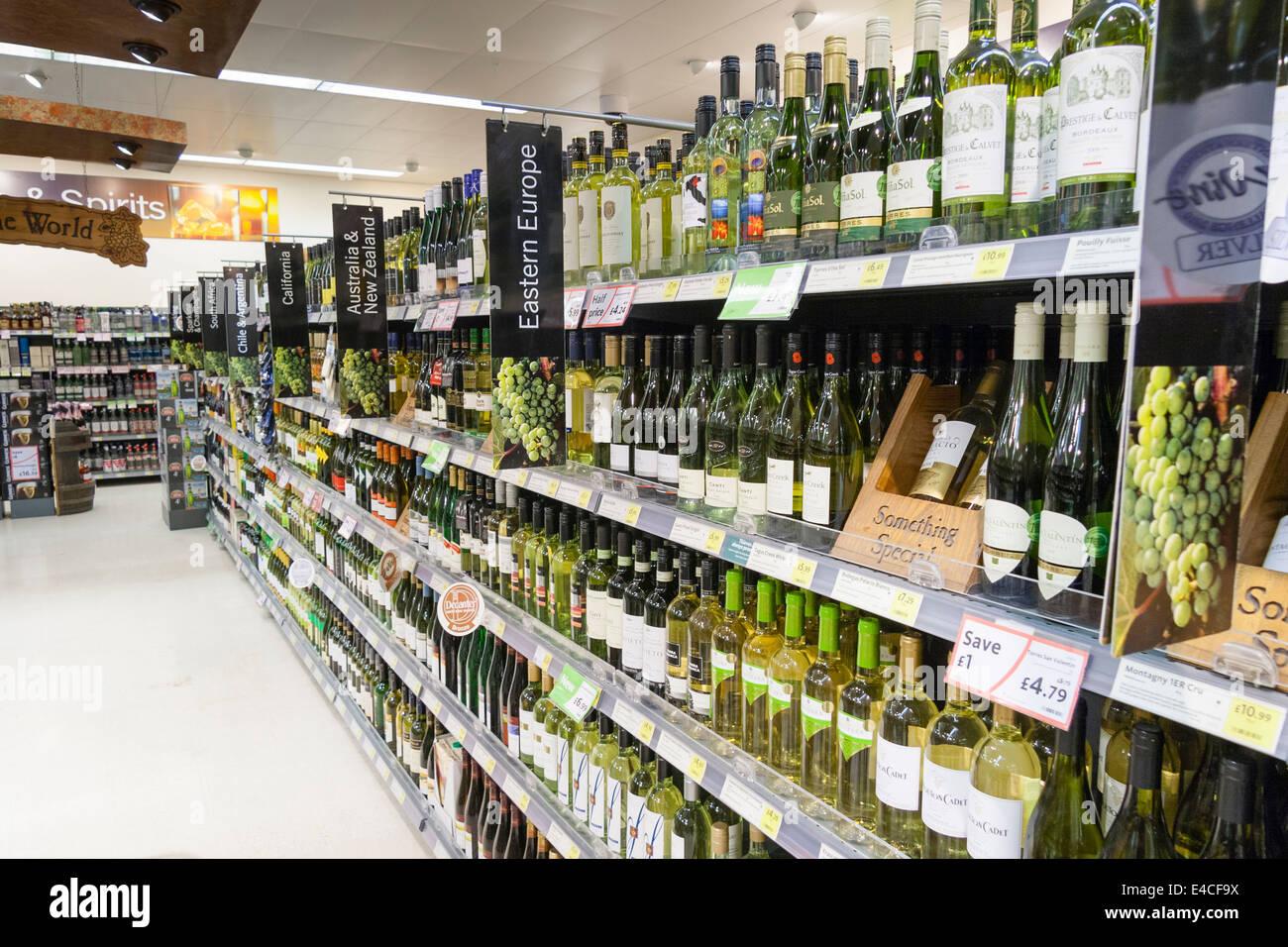 Bottles of white wine on shelves in a British supermarket - Stock Image