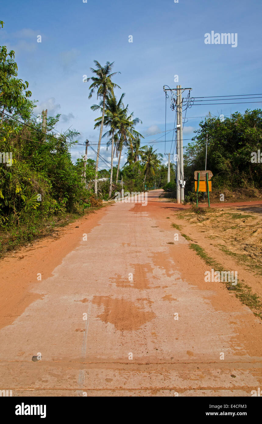 Red dirt road near Ong Lang Beach, Phu Quoc island, Vietnam - Stock Image