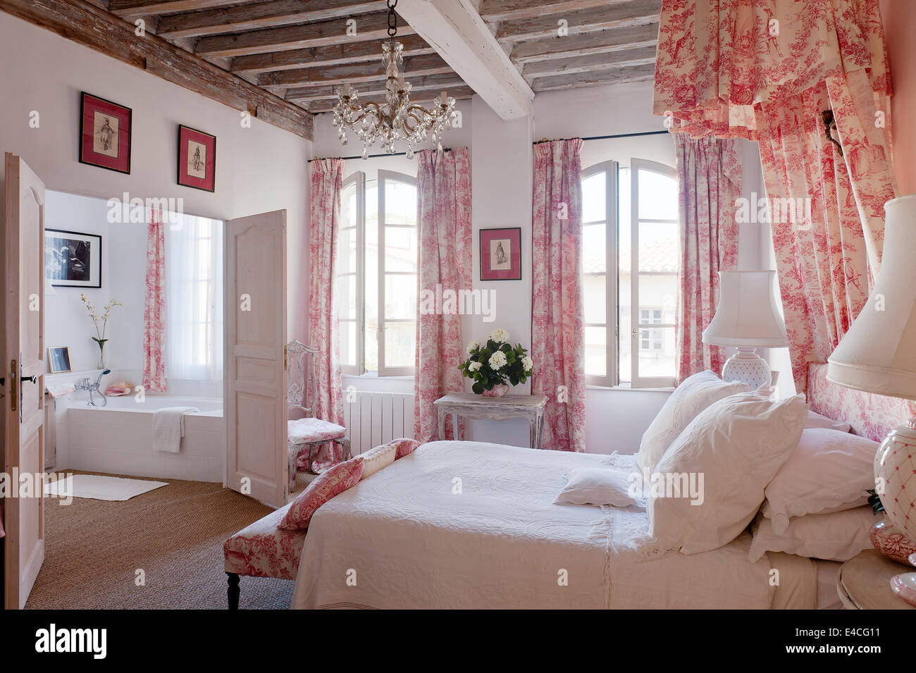 Pink and white toile de jouy fabric on cushions, curtain and bed ...