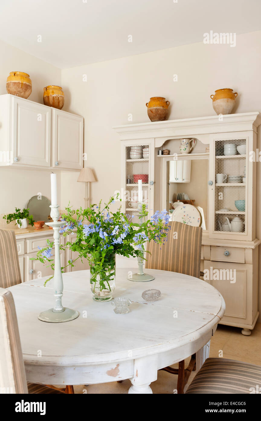 Distressed White Dining Table In Provencal Style Country Kitchen With  French Dresser   Stock Image