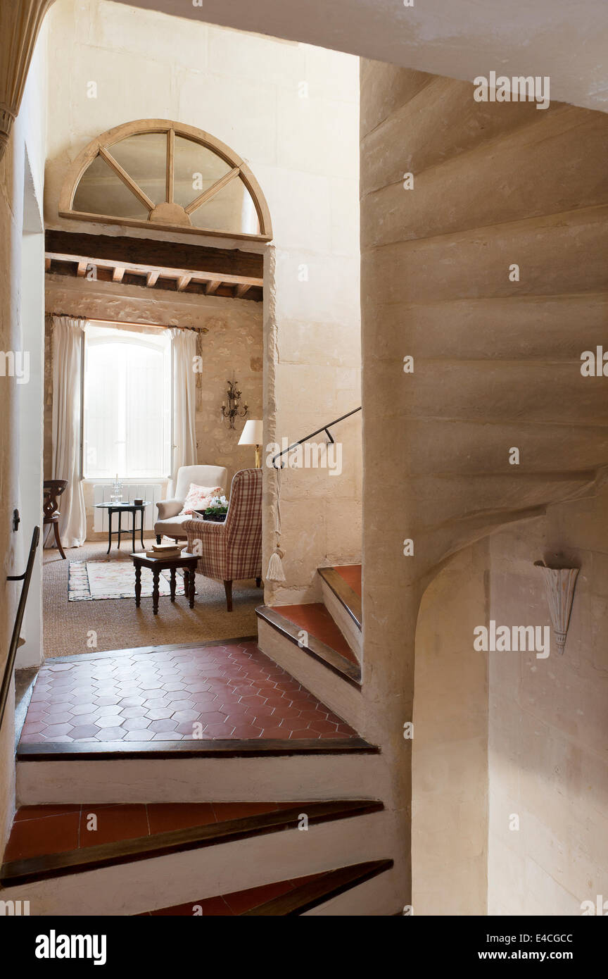 Terracotta hexagonal tiles on curved stone staircase - Stock Image
