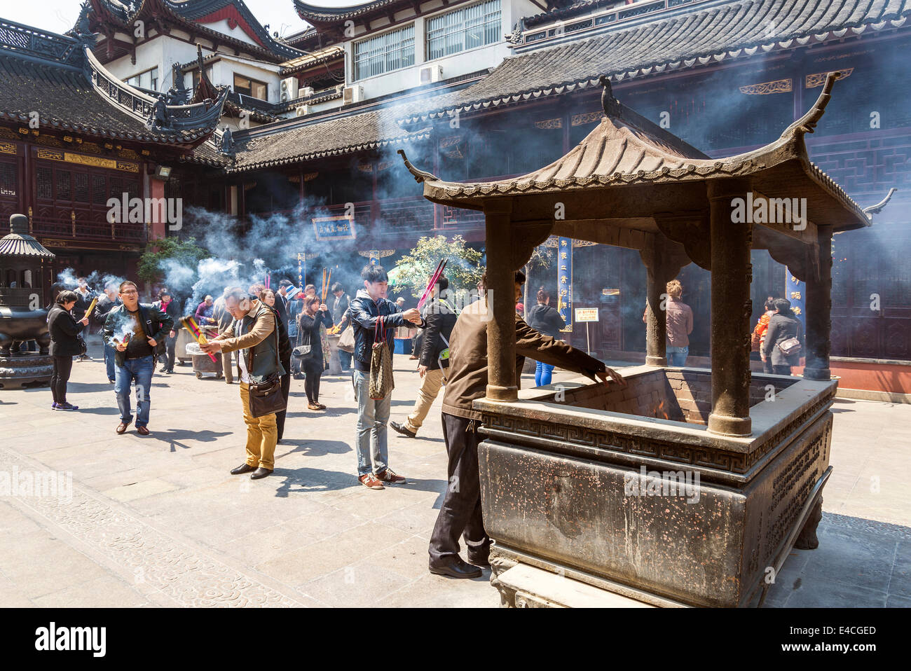 incense burning in shanghai china old town temple - Stock Image