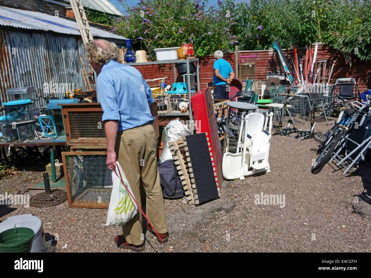 Customers browsing in junkyard in Wellington, Somerset - Stock Image