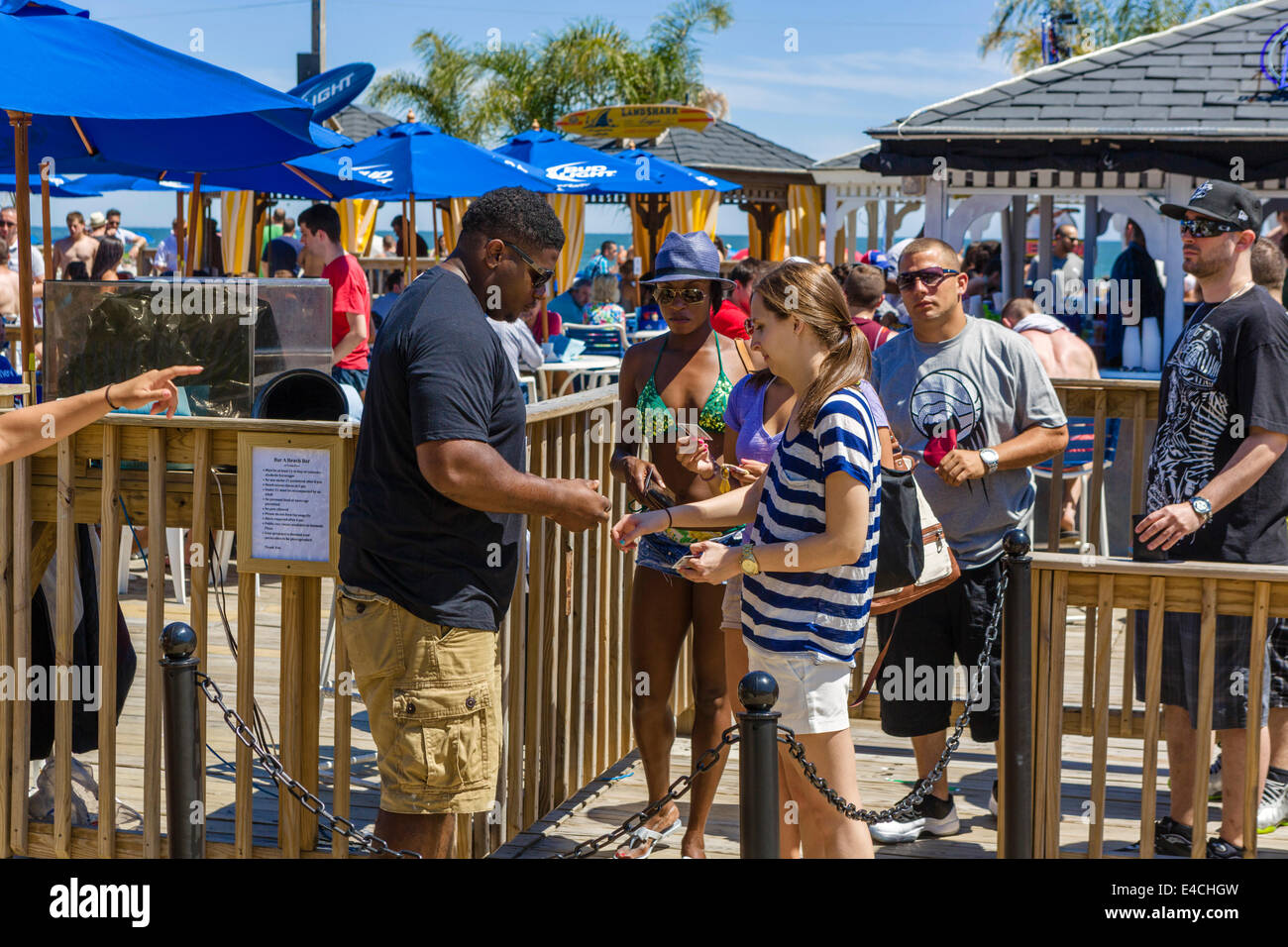 Young people having their ID checked for age at Bar A Beach Bar at Trump Plaza, Atlantic City, New Jersey, USA - Stock Image