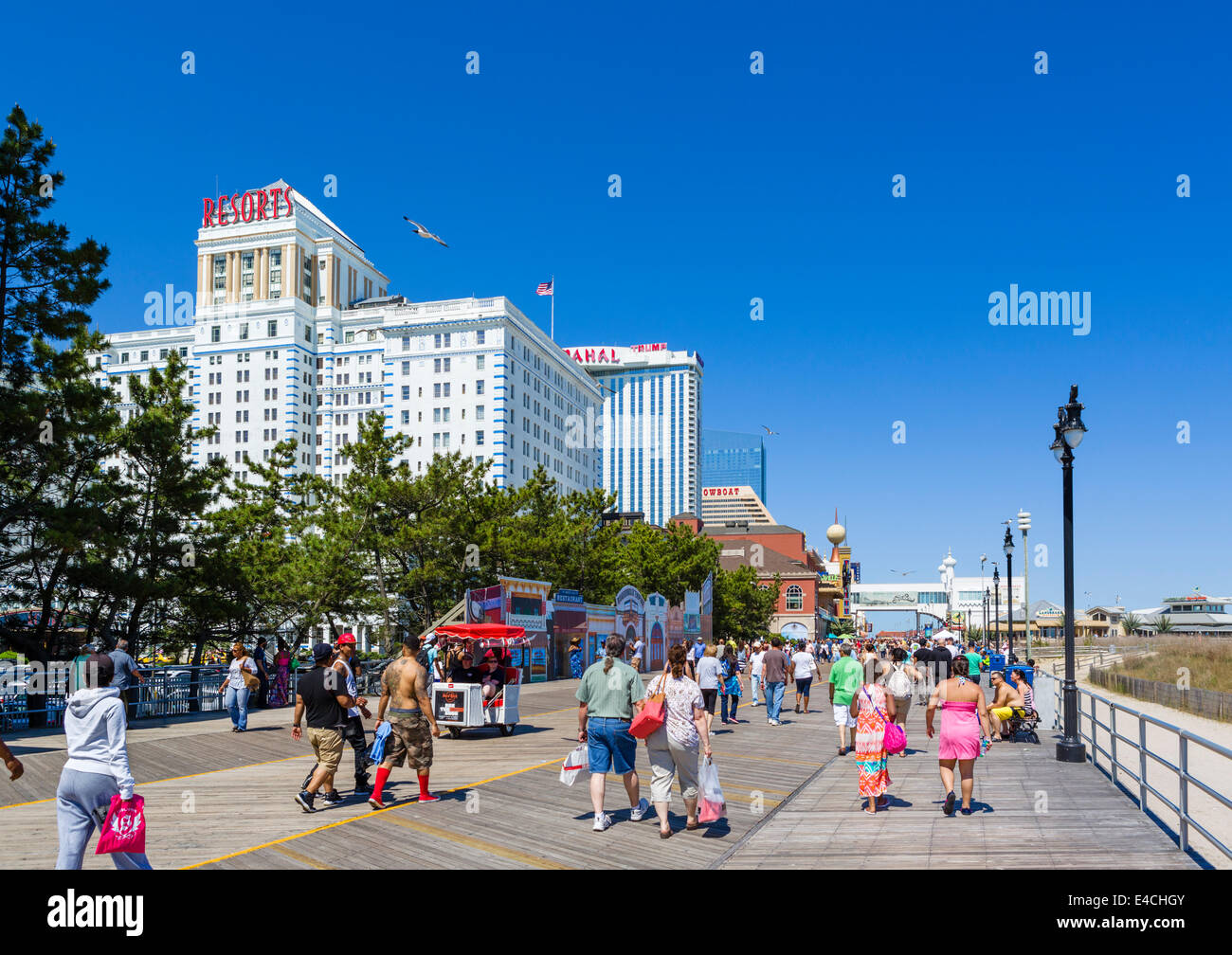 The boardwalk looking towards the Taj Mahal Casino and Steel Pier, Atlantic City, New Jersey, USA - Stock Image