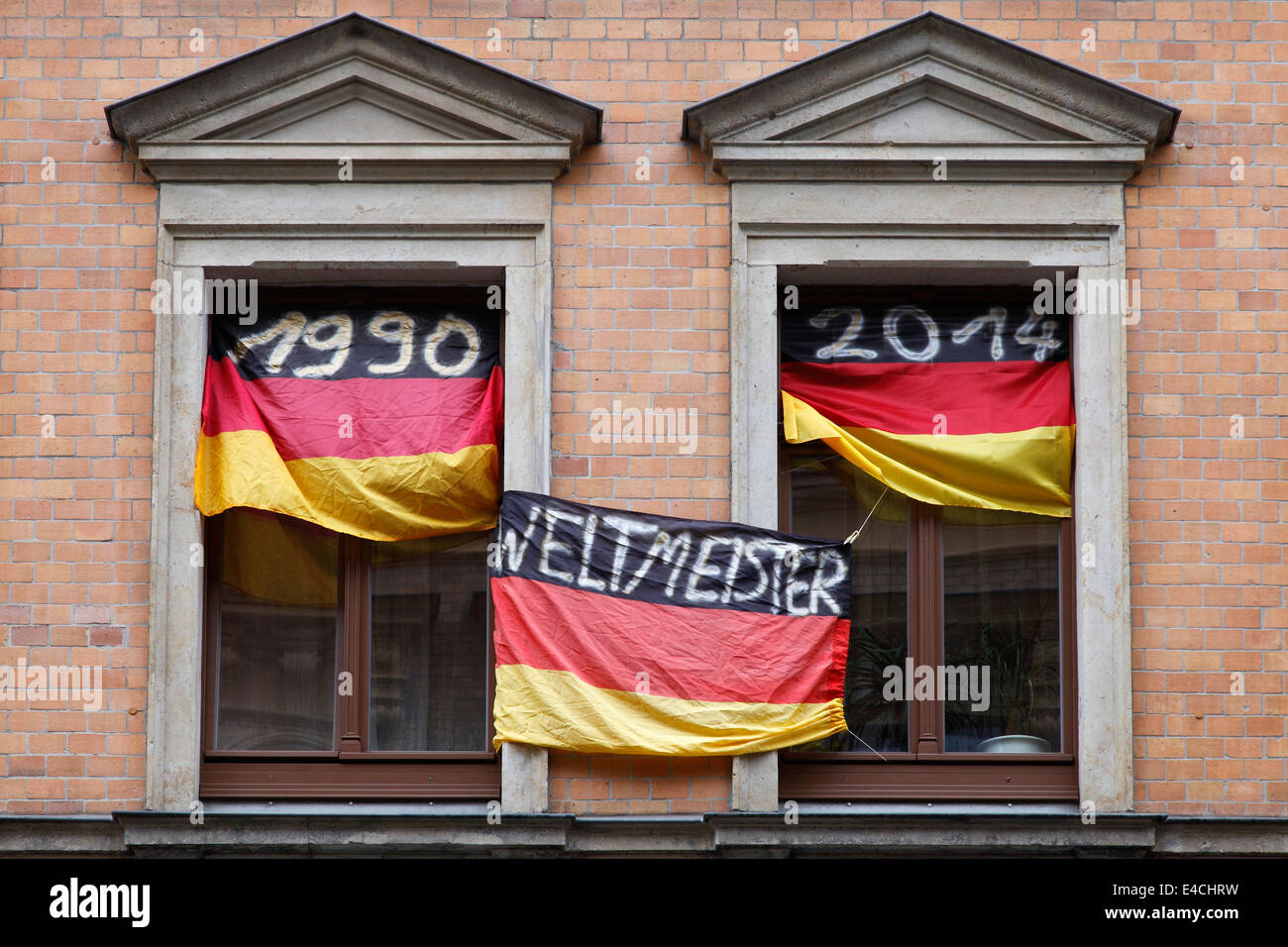 Germany Football World Champion 1954 1974 1990 and 2014; Flags with the year dates at the windows of an German fan - Stock Image