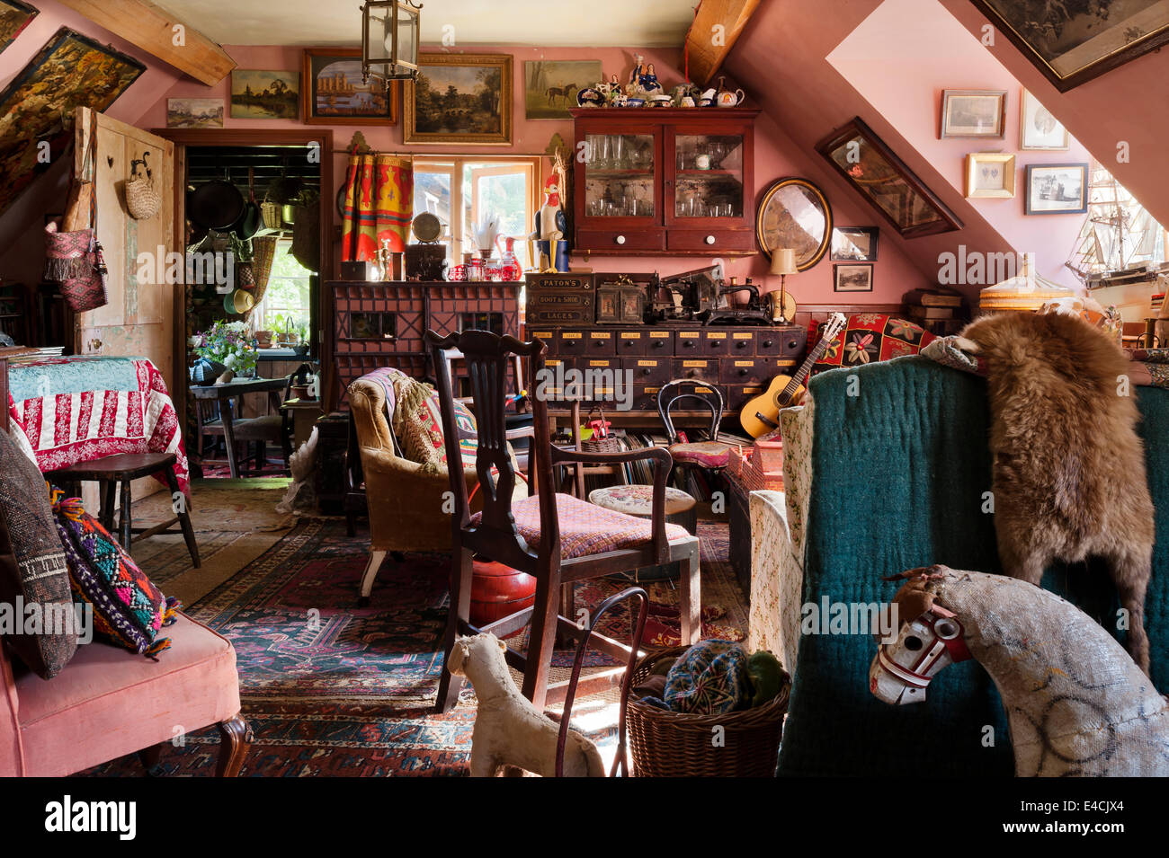 Cluttered cottage living room full of antique furniture, artwork, old toys  and vintage textiles - Cluttered Cottage Living Room Full Of Antique Furniture, Artwork