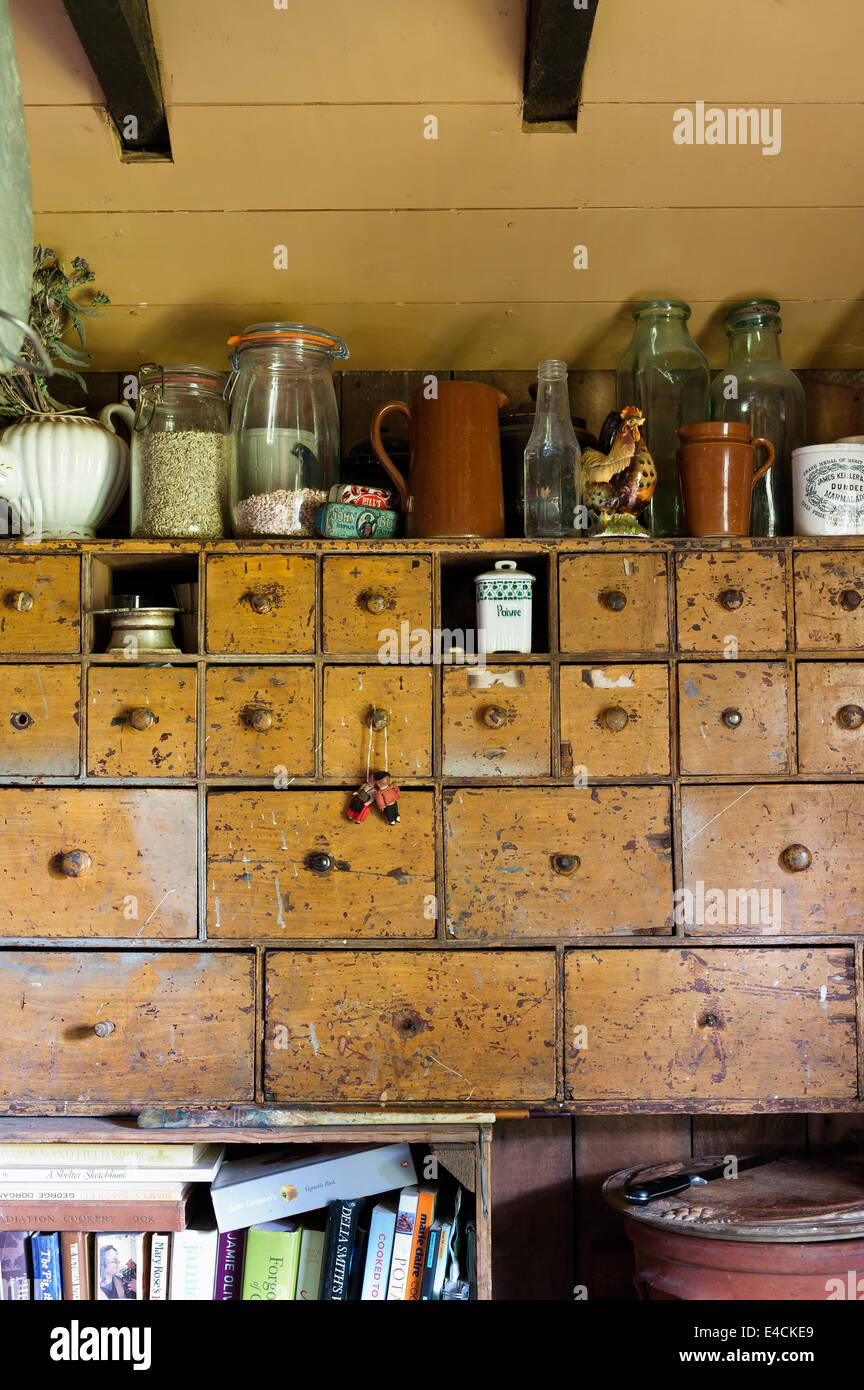 Old chemist drawers  used for storage in country kitchen - Stock Image