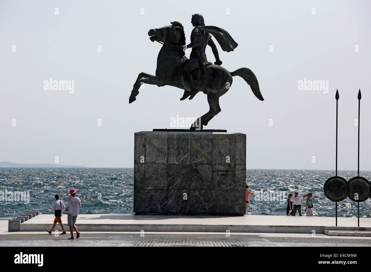 Tourists walk past Alexander the Great statue in Thessaloniki, Greece - Stock Image