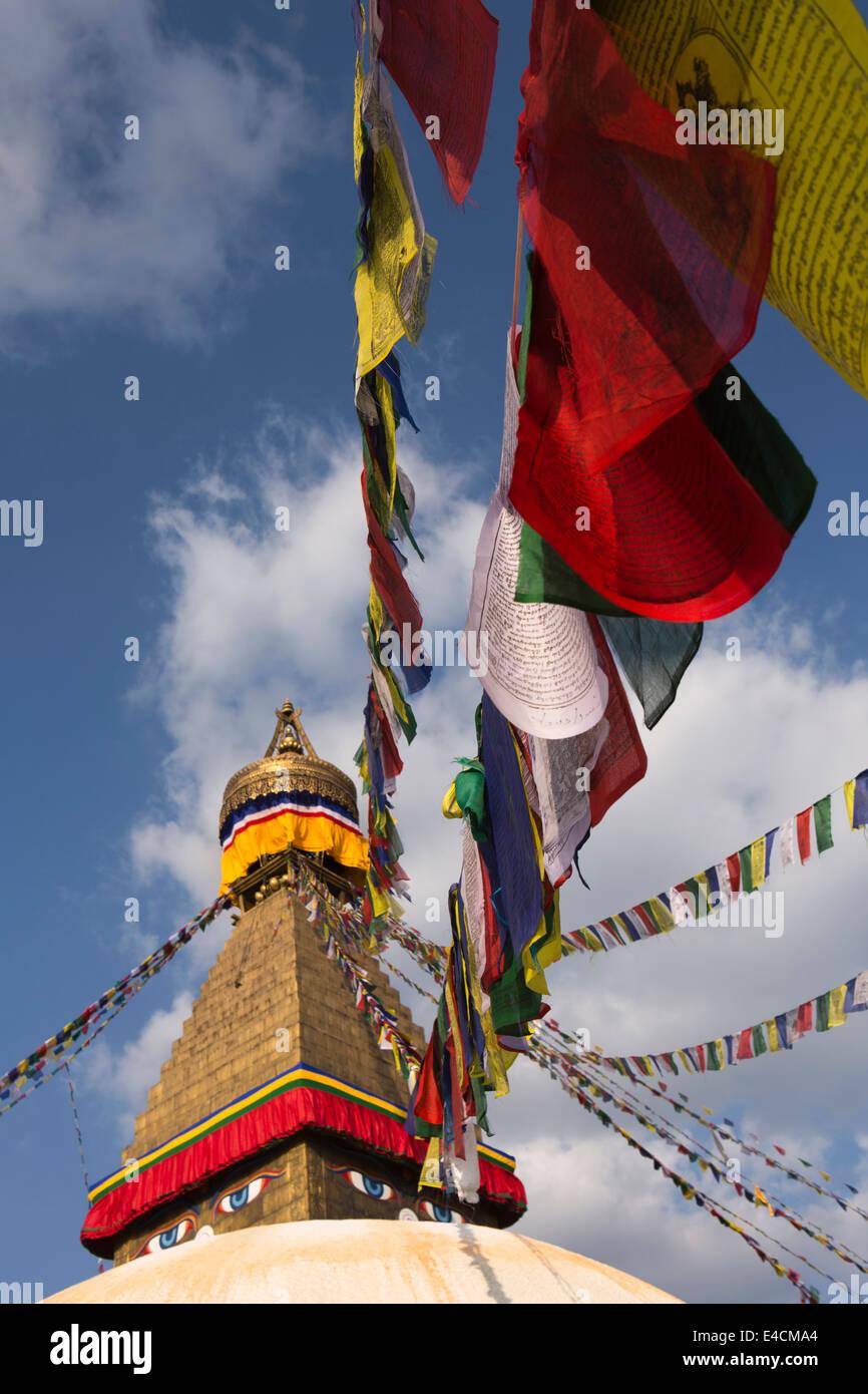 Nepal, Kathmandu, Boudhanath, stupa spire, with colourful prayer flags - Stock Image
