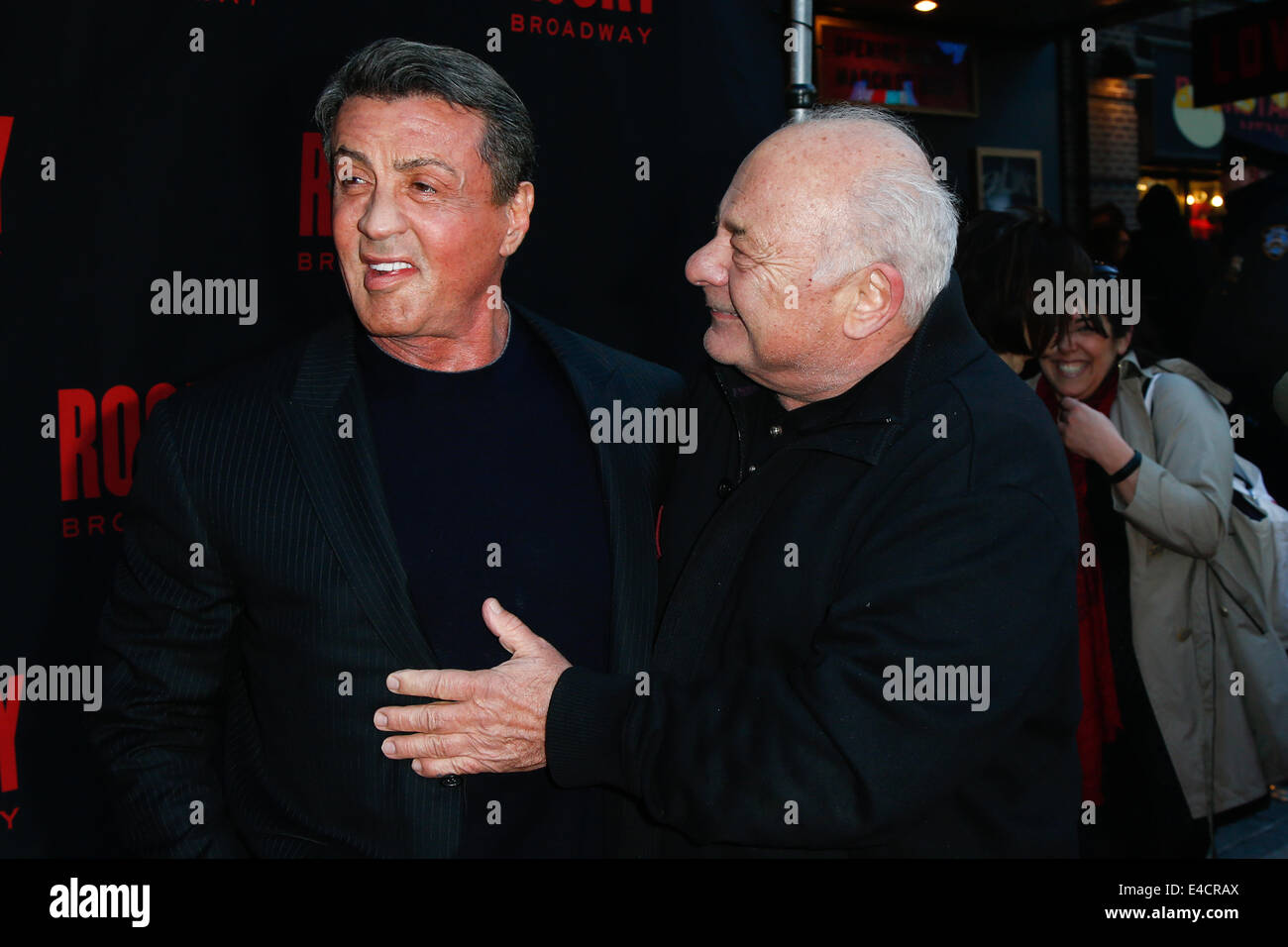 Actors Sylvester Stallone (L) and Burt Young attend the 'Rocky' Broadway opening night at the Winter Garden Theatre. Stock Photo