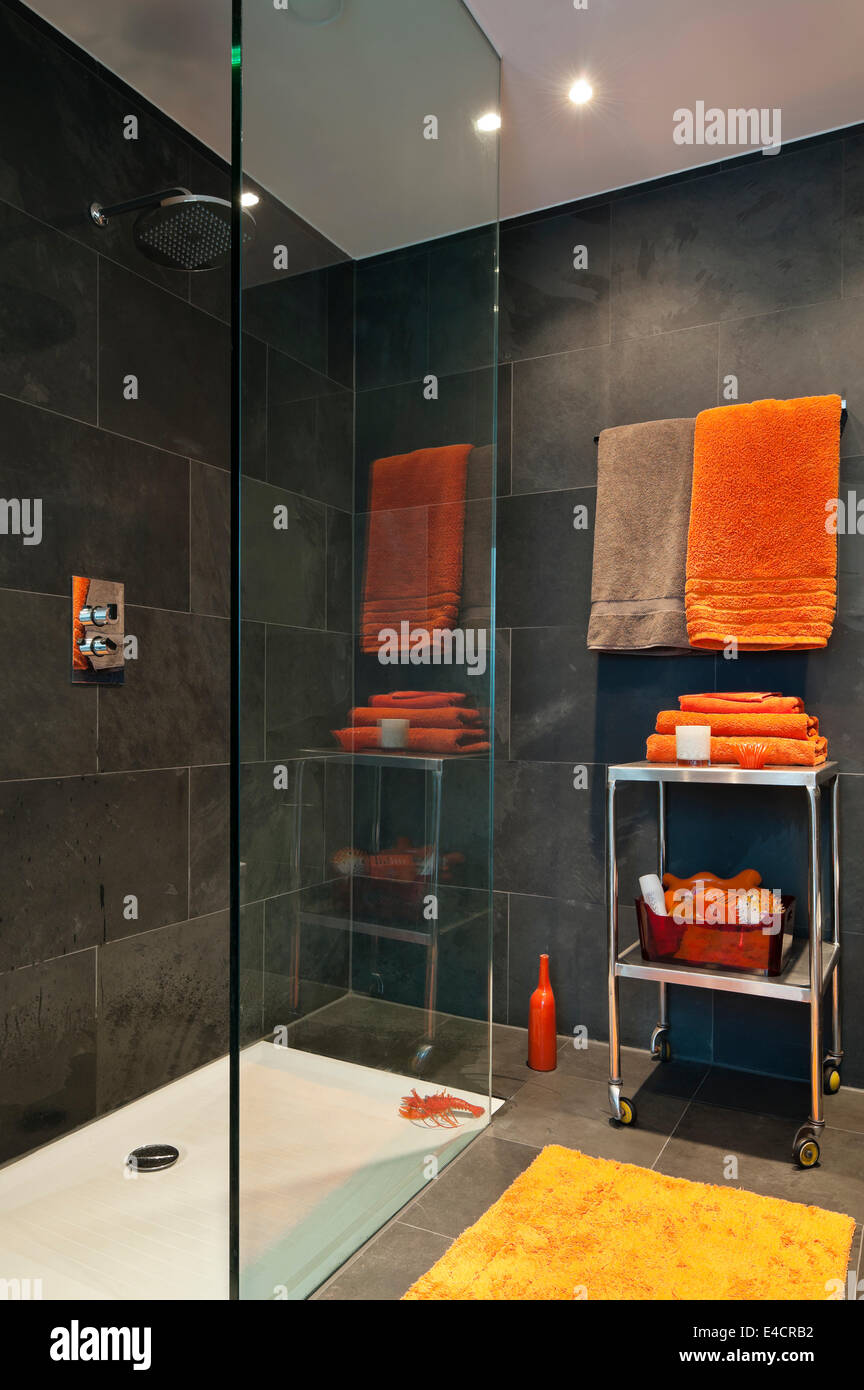 Bright Orange Towels In Bathroom With Slate Tiles Stock Photo Alamy