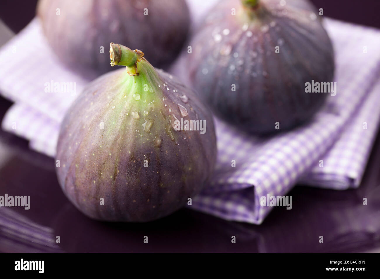 Figs in Purple Bowl - Stock Image